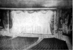 Taken from the top of the loge section, this picture by L. V. McNeeley, Deseret News staff photographer, shows main auditorium of the Villa Theater.  Note lavish curtains over screen.