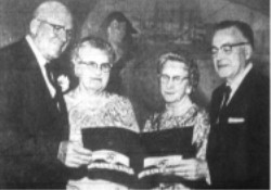 Gov. and Mrs. George D. Clyde, left discuss Cinerama with Elder Harold B. Lee of the council of the Twelve, Church of Jesus Christ of Latter-Day Saints, and Mrs. Lee.