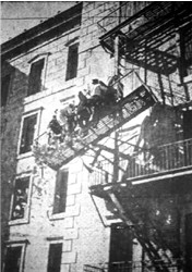 Stars of 'Mad, Mad, Mad, Mad World,' which opens tonight at the Villa Cinerama Theater, teeter precariously on a fire escape as money falls to the ground.