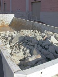 Concrete rubble in a dumpster outside the Villa Theatre