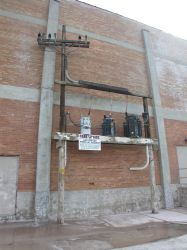 Utility pole and transformers on the north side of the Villa Theatre