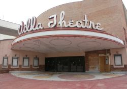 The front of the Villa Theatre. The pink paint is being removed from the Villa's exterior walls.